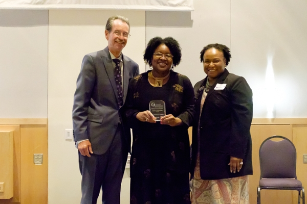 Drs. Benson and Harris present Dr. Joanne Gabbin with the Lifetime Achievement Award for her years of work with the Furious Flower Poetry Center and the Honors Program.
