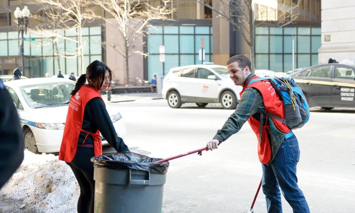 Photo of two JMU students working in Boston during Alternative Service Break