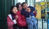 Michelle Amaya ('14) with Bolivian girl and boy in La Paz.