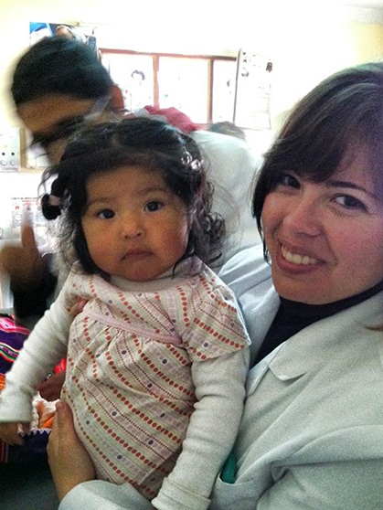 Michelle Amaya and young Bolivian girl with doctor.