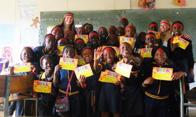 Students from South Africa proudly display their STAR Student certificates with JMU student Jenn Bailey