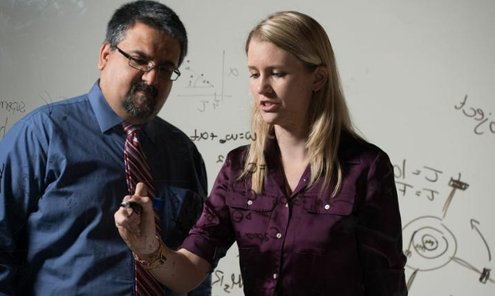 Devin Buennemeyer ('16), JMU  physics major, with professor Shanil Virani
