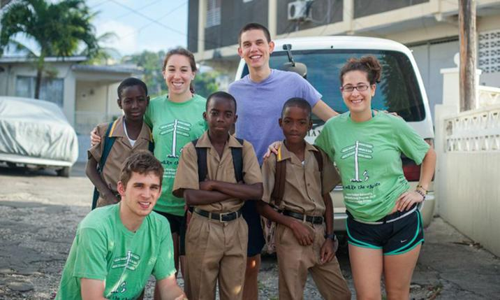Brian Caperton (lower left) and friends pose for picture during JMU Alternative Spring Break trip in Jamaica
