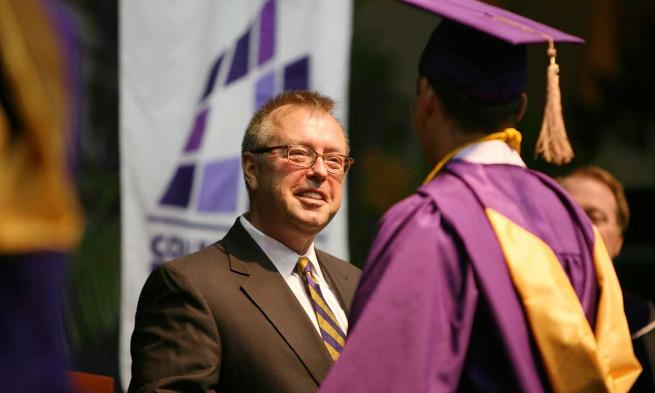 Don Rainey ('82) congratulates new members of Class of 2013