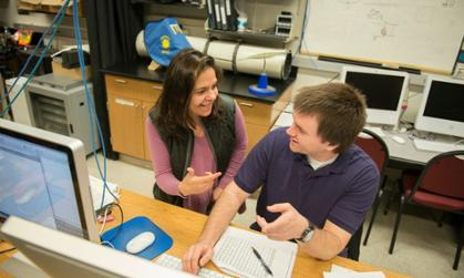 Dr. Anca Constantin and physics major Emil Christensen.