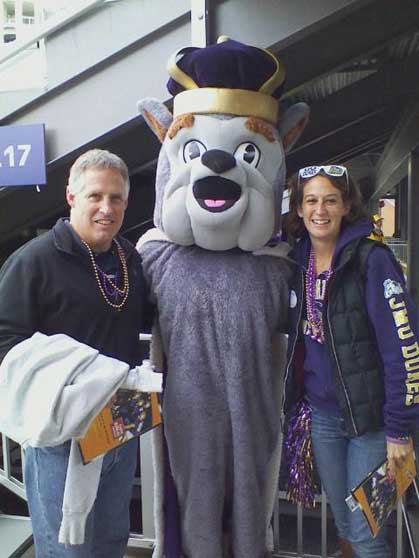 Kelley Freund and her dad share a moment with Duke Dog at Homecoming 2012