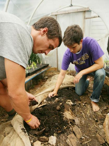 Sam Frere (left) and Nick Geer work together at Collicello Urban Gardens