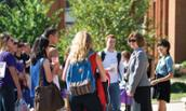 College of Business Dean Mary Gowan talks to students on JMU campus