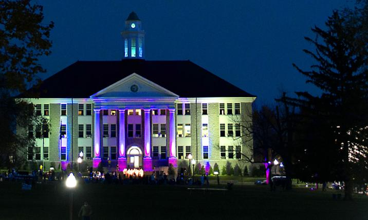 Image of Wilson Hall at dusk lit with purple