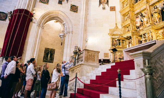 Students learn about the history and architecture of Granada Cathedral in Spain