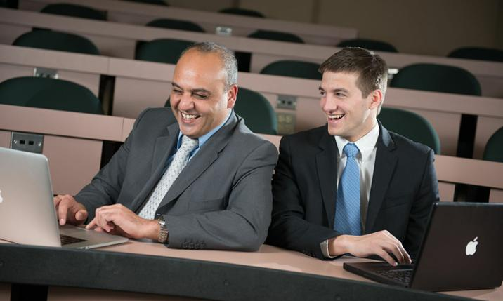 Madison Investment Fund adviser Elias Semaan and J.P. Kril ('13)