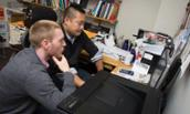 Photo of professor Matt Lee and JMU student Ethan Bannar in CARDS lab
