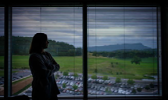 Photo of JMU nursing professor Erica Lewis gazing out hospital window