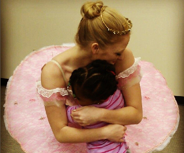Caitlin McAvoy as Sugar Plum Fairy enjoys a hug from a fan