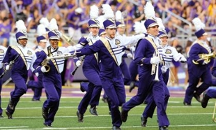 Section of Marching Royal Dukes run to football field to perform
