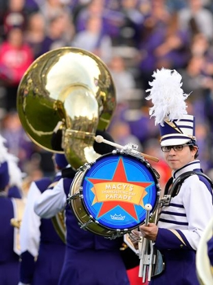 A Marching Royal Dukes drummer proudly displays the Macy's Thanksgiving Day Parade logo.