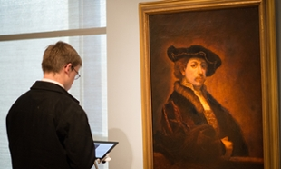 Visitors enjoy Rembrandt exhibit