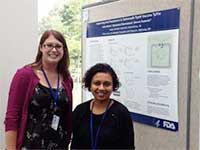 Carly Starke poses with Dr. Madushini Dharmasena at NIH poster session