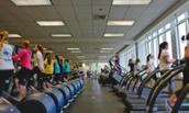 Photo of JMU students working out at UREC
