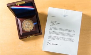 A Killian Award and letter of thanks from President Clinton are some of the recognition Walton has received for his intelligence work.