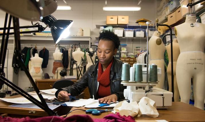 Dance major Kenisha Washington in the costume shop at JMU