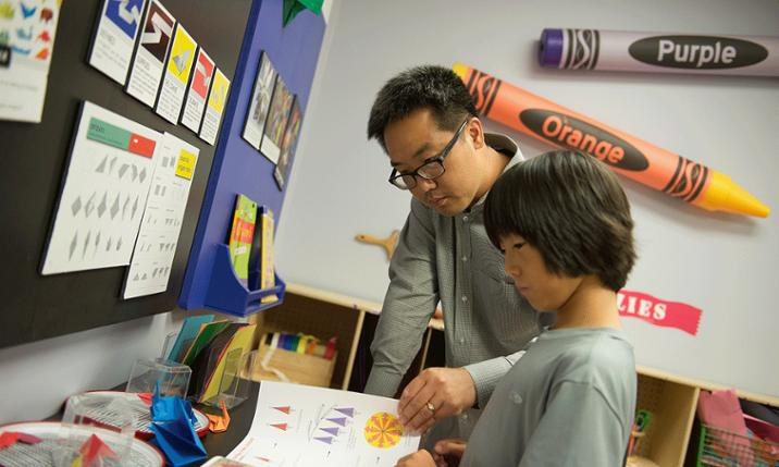 Photo of Dr. Isaac Woo with his son