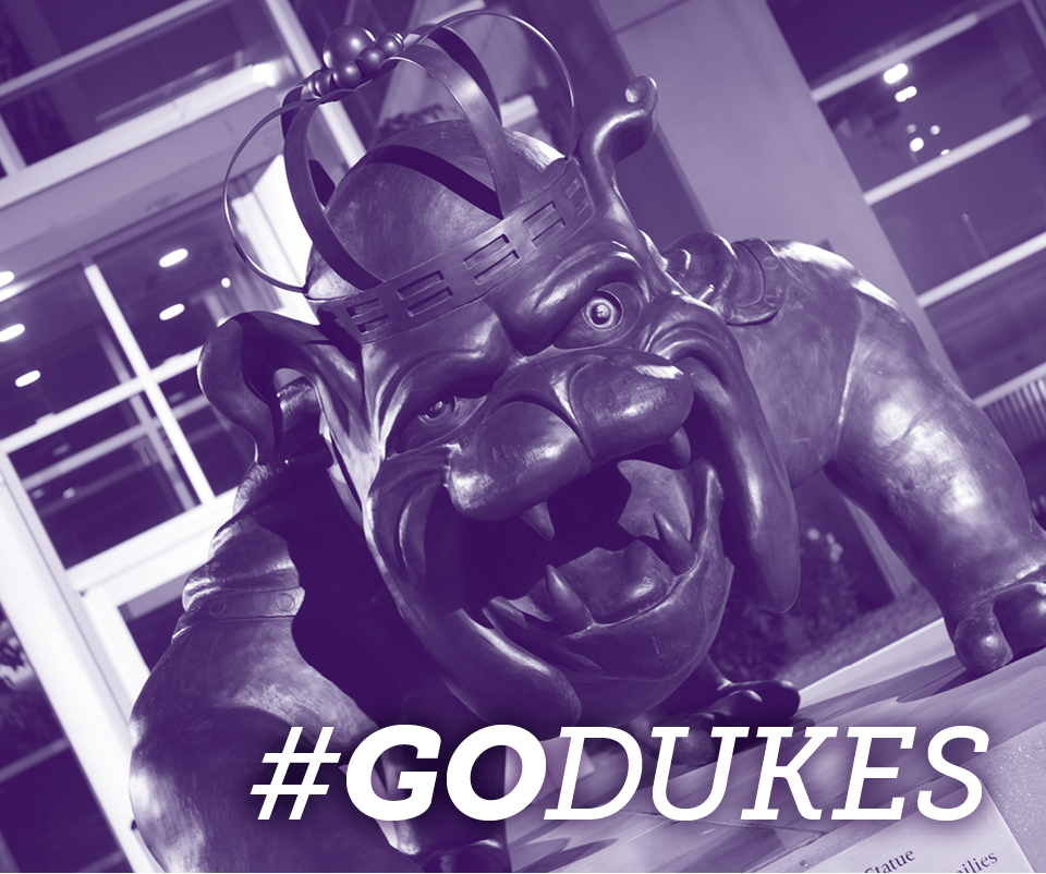 Styled photo of the Duke Dog statue with text #GoDukes