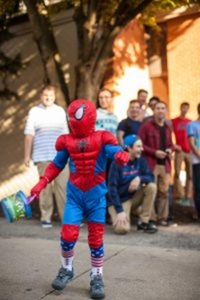 This little Spiderman is enjoying his early Halloween on Greek Row.