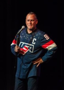 Here is Dave Coulier laughing along with one of his jokes.