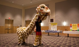 Performance of the Lion Dance by members of the Chinese Student Association at the 2012 Holiday Celebration hosted by the Peer Mentorship Program in the Festival Ballroom.