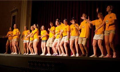 JMU First Year Orientation Guides perform the FrOG dance.