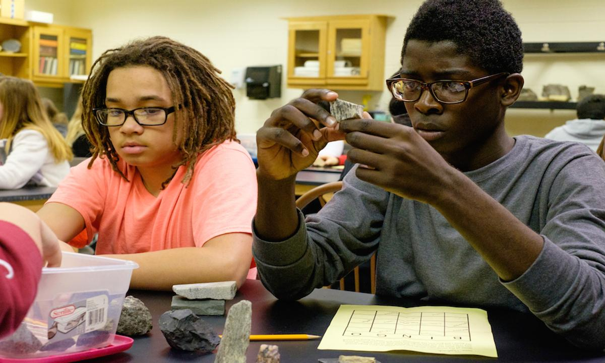 Scholars examine rocks with the Geology department