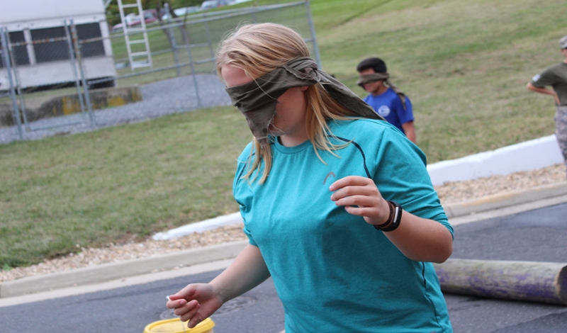Scholar wears blindfold during edeucational day