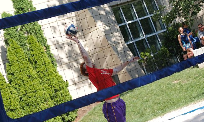 Photo of JMU student playing volleyball at UREC