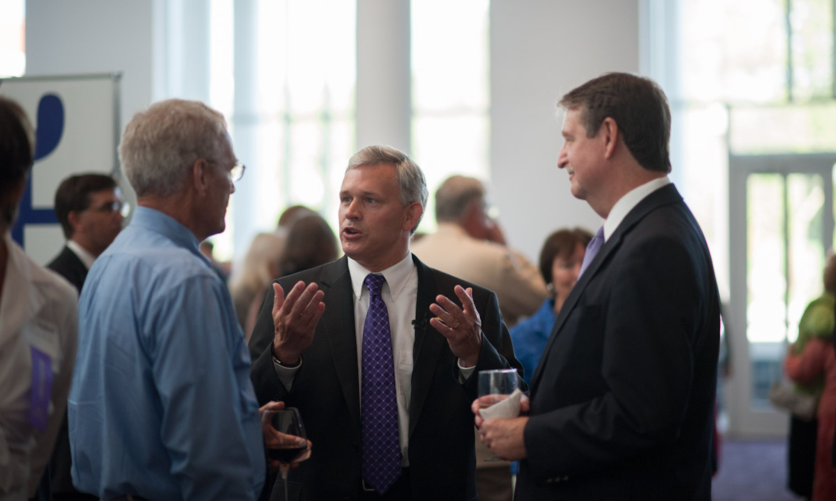 Rex Fuller, President Jonathan Alger and Steve Smith ('71)