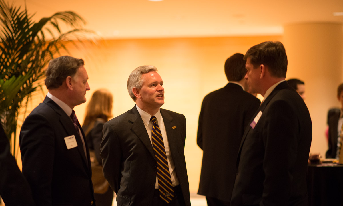 David Brakke, President Jon Alger and David Chipman ('83)
