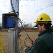 Image of Dr. Miles working on a data logger