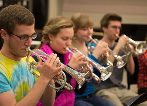 Trumpeters practicing during class
