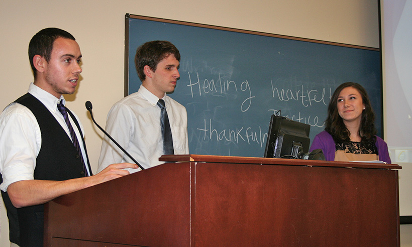 Three counseling students presenting at a conference