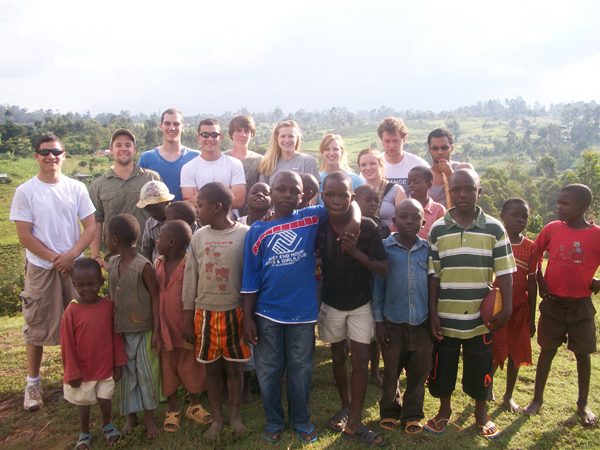 Group of JMU students and African children