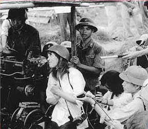 Jane Fonda with a North Vietnamese gun crew.
