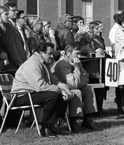 At Madison College's first football game, President Ronald E. Carrier (left) and Vice President Ray V. Sonner sat in folding chairs and watched from the sidelines.