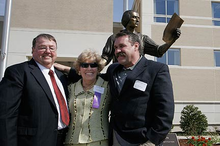 Bruce and Lois Forbes and Lee Leuning in front of the statue
