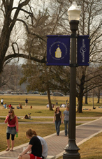 Centennial Pole Banners on Lamps on the Quad