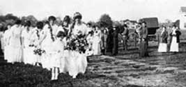 Elizabeth Kelly, the first May Queen, leads her Court in the 1913 celebration.