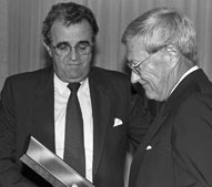 Dr. Ray Sonner (right), originator of the Duke Dog, with President Ronald E. Carrier at the dedication of Sonner Hall in 1990.