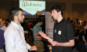 Males communicating at CISE Career Fair