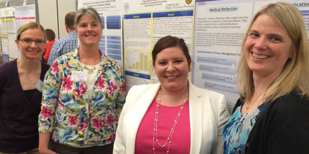 Heather Carmack with other poster presenters at DCHC2015