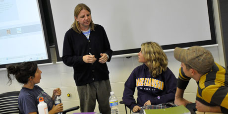 Professor Pete Bsumek meets with students