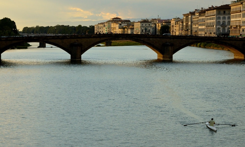 Rower over the Arno in Florence